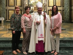 Teachers with Bishop at ceremony